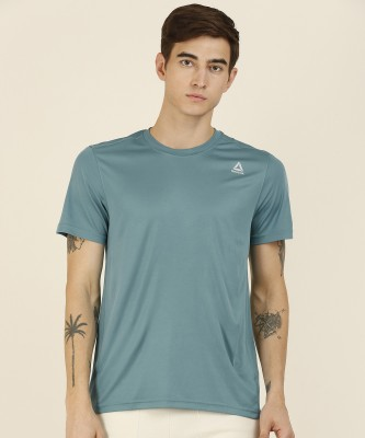 REEBOK Solid Men Round Neck Blue T-Shirt